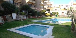Lloret de Mar: séjournez au cœur de la ville  Situé à 100 mètres de la plage Lloret de Mar, l'Apartamento Punta Marinera propose une piscine extérieure commune et une zone de pelouse. Cet appartement climatisé dispose d'un lave-linge.