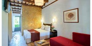 Ce petit hôtel champêtre dispose de 3 hectares de jardins et de 2 piscines extérieures. Il se trouve dans le village médiéval de Peratallada, à 15 minutes en voiture de la Costa Brava.