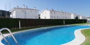 Le Chic Apartments Port d'Aro est situé à Platja d'Aro. Il possède une piscine d'eau salée commune et un jardin.